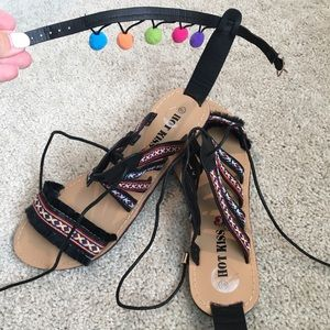 Hot Kiss sandals in black and assorted colors.